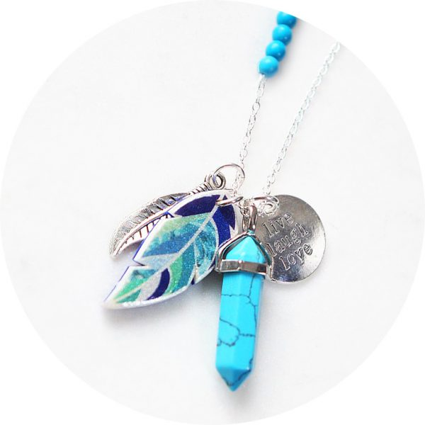 A fun boho style gemstone necklace with Next Romance signature feather, affirmation charm, pendulum gemstone and matching gem detail on a classic long chain.