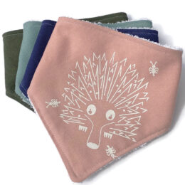 Echidna critter design on bandana bib in dusty pink with other bib colours shown.